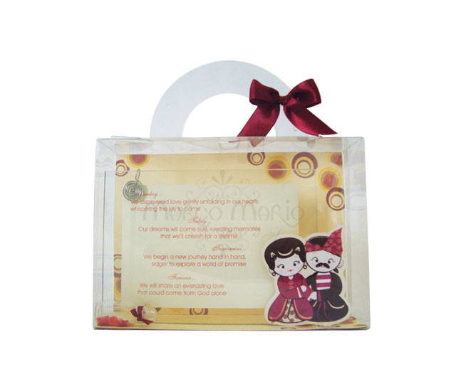 madura couple photo frame,marco mario souvenir, wedding souvenirs, souvenir pernikahan
